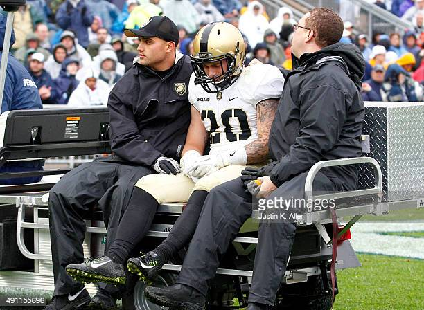 Rhyan England of the Army Black Knights is carted off the field with an injury in the second half during the game against the Penn State Nittany...
