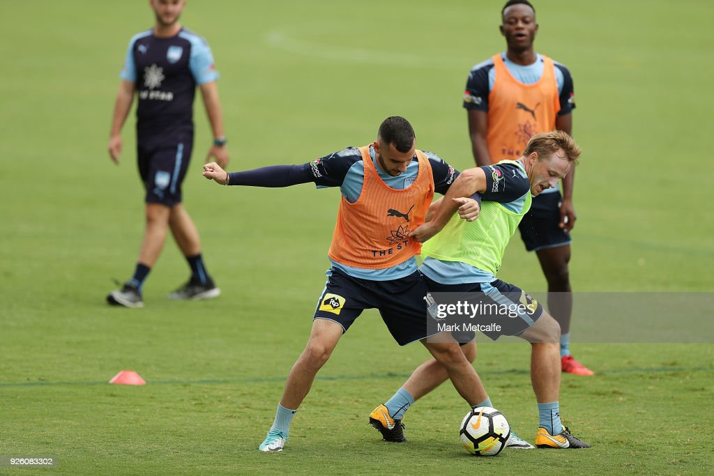 Rhyan Grant competes with Anthony Kalik during a Sydney FC A-League training session at Macquarie Uni on March 2, 2018 in Sydney, Australia.