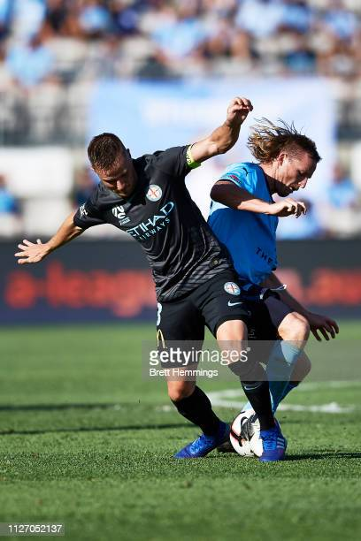Rhyan Grant of Sydney and Scott Jamieson of Melbourne City contest the ball during the round 17 ALeague match between Sydney FC and Melbourne City at...
