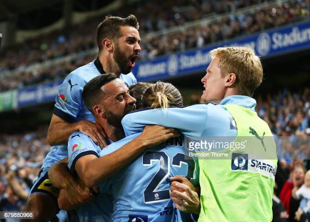 Rhyan Grant of Sydney celebrates with team mates after scoring a goal during the 2017 ALeague Grand Final match between Sydney FC and the Melbourne...