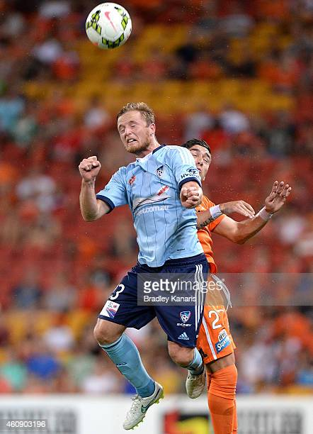 Rhyan Grant of Sydney FC and Dimitri Petratos of the Roar challenge for the ball during the round 14 ALeague match between the Brisbane Heat and...