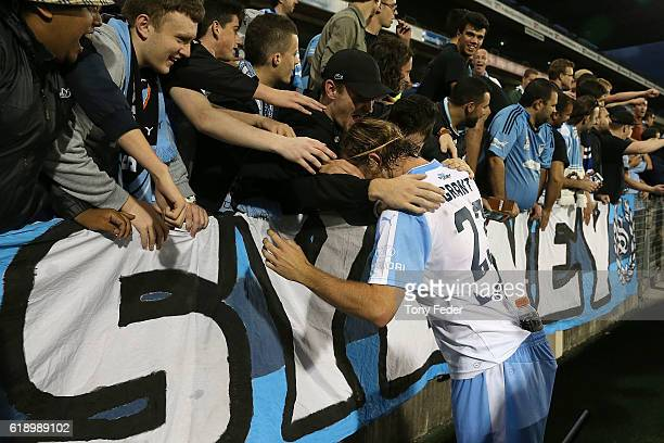 Rhyan Grant of Sydney FC celebrates with fans after beating the Jets during the round four ALeague match between the Newcastle jets and Sydney FC at...