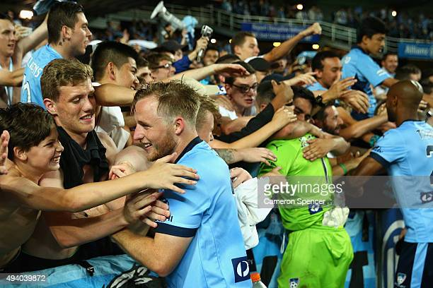 Rhyan Grant of Sydney FC celebrates with fans after winning the round three ALeague match between Sydney FC and Western Sydney Wanderers at Allianz...
