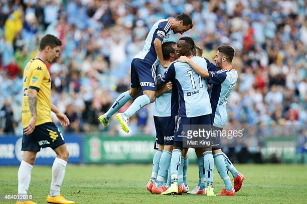 Rhyan Grant of Sydney FC celebrates with team mates after scoring a goal as Alex Brosque of Sydney FC jumps over the top during the round 18 ALeague...