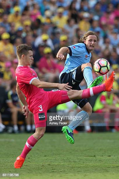 Rhyan Grant of Sydney FC contests the ball against Scott Galloway of the Mariners during the round 14 A-League match between the Central Coast...