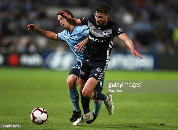 Rhyan Grant of Sydney FC is challenged by Terry Antonis of the Victory during the A-League Semi Final match between Sydney FC and the Melbourne...