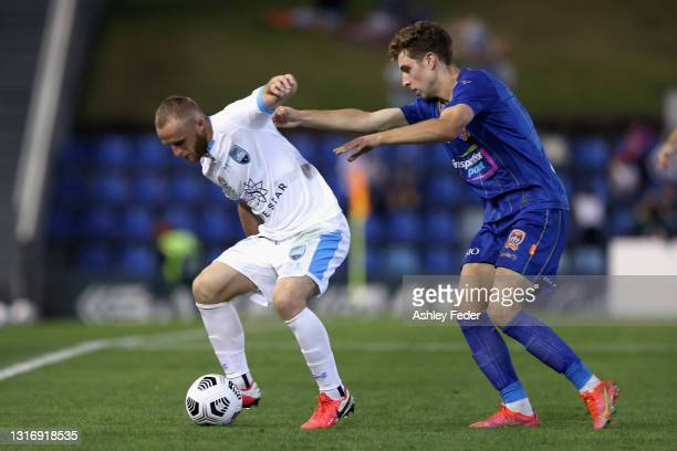 Rhyan Grant of Sydney FC is contested by Luka Prso of the Jets during the A-League match between Newcastle Jets and Sydney FC at McDonald Jones...