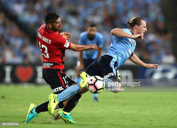Rhyan Grant of Sydney FC is tacked by Bruno Pinatares of the Wanderers during the round 20 ALeague match between the Western Sydney Wanderers and...