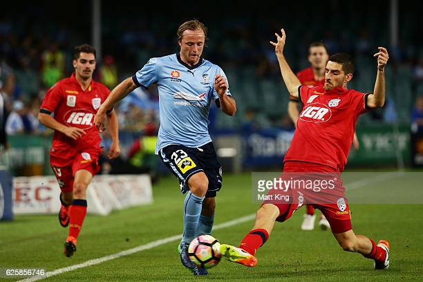 Rhyan Grant of Sydney FC is tackled by Iacopo La Rocca of United during the round eight ALeague match between Sydney FC and Adelaide United at...