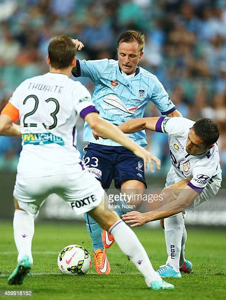 Rhyan Grant of Sydney takes on Perths defence during the round 10 ALeague match between Sydney FC and Perth Glory at Allianz Stadium on December 4...