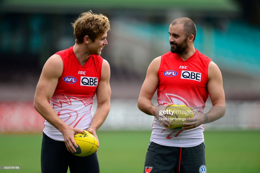 Rhyce Shaw of the Swans speaks with Dane Rampe during a Sydney Swans AFL training session at Sydney Cricket Ground on July 24, 2014 in Sydney, Australia.