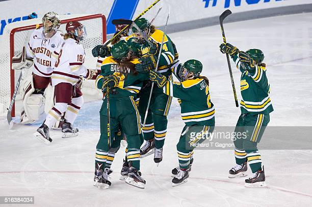 Rhyen McGill of the Clarkson Golden Knights celebrates her goal against the Boston College Eagles with her teammates Genevieve Bannon Corie Jacobson...