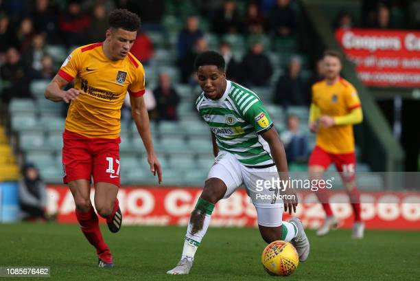 Rhys Browne of Yeovil Town controls the ball watched by Shaun McWilliams of Northampton Town during the Sky Bet League Two match between Yevoil Town...