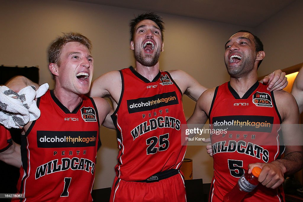 Rhys Carter, Jeremiah Trueman and Everard Bartlett of the Wildcats celebrate winning the round 24 NBL match between the Perth Wildcats and the New Zealand Breakers at Perth Arena on March 22, 2013 in Perth, Australia.