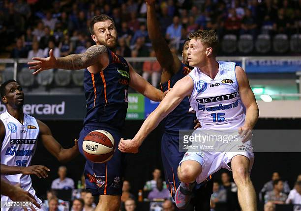 Rhys Carter of The Breakers passes under pressure from Cameron Tragardh of the Taipans during the round three NBL match between the New Zealand...