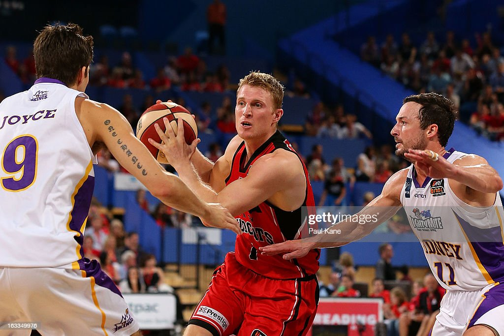 Rhys Carter of the Wildats looks to drive to the basket against Daniel Joyce and Aaron Bruce of the Kings during the round 22 NBL match between the Perth Wildcats and the Sydney Kings at Perth Arena on March 8, 2013 in Perth, Australia.