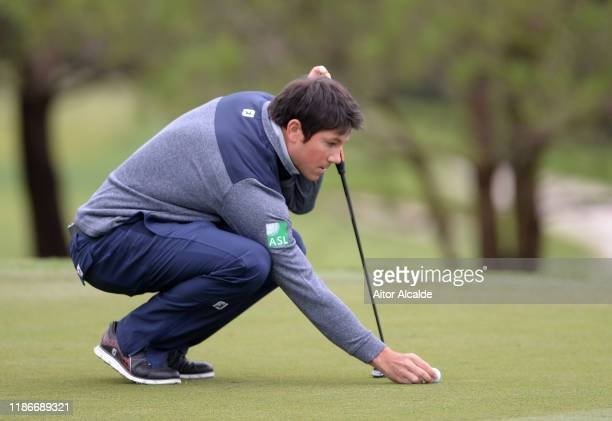 Rhys Enoch of Wales lines up a putt on the 4th green during day 4 of the Challenge Tour Grand Final at Club de Golf Alcanada on November 10 2019 in...