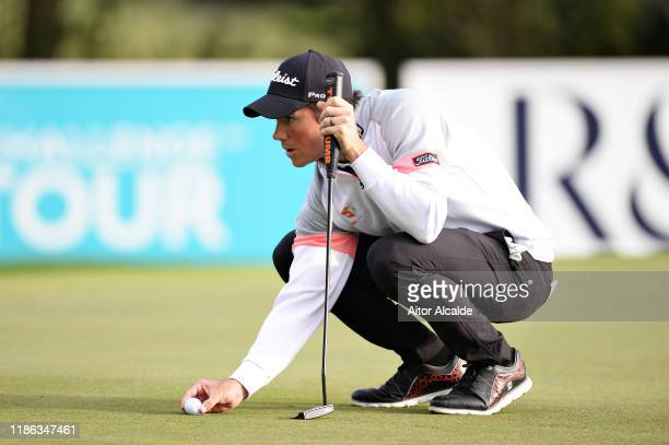Rhys Enoch of Wales lines up a putt on the eighteenth green during day 2 of the Challenge Tour Grand Final at Club de Golf Alcanada on November 08...