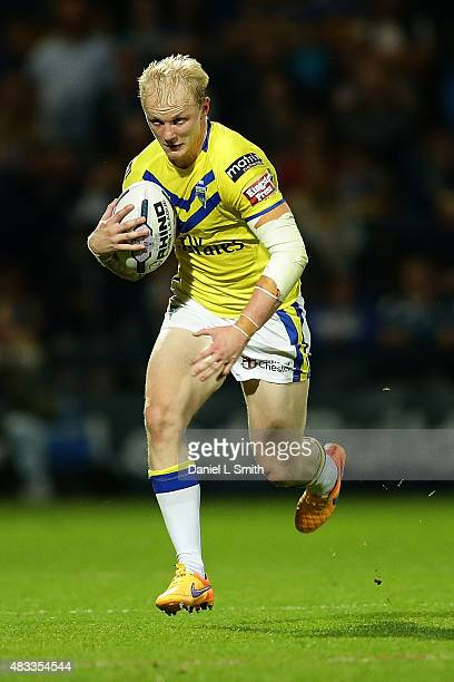 Rhys Evans of Warrington Wolves runs with possession during the Round 1 match of the First Utility Super League Super 8s between Leeds Rhinos and...