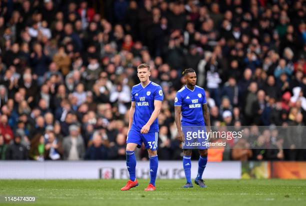 Rhys Healey and Leandro Bacuna of Cardiff City look dejected after Fulham's first goal during the Premier League match between Fulham FC and Cardiff...