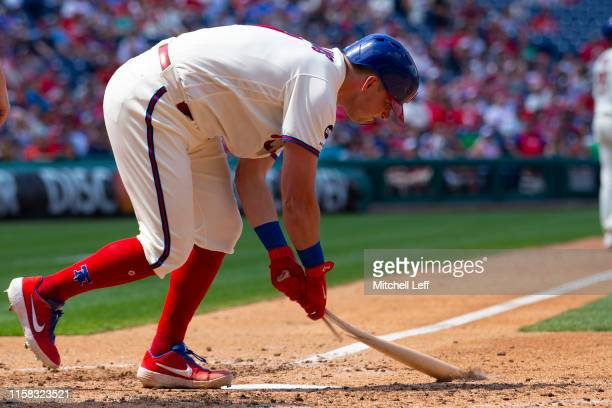 Rhys Hoskins of the Philadelphia Phillies breaks his bat after popping out with the bases loaded in the bottom of the fifth inning against the...