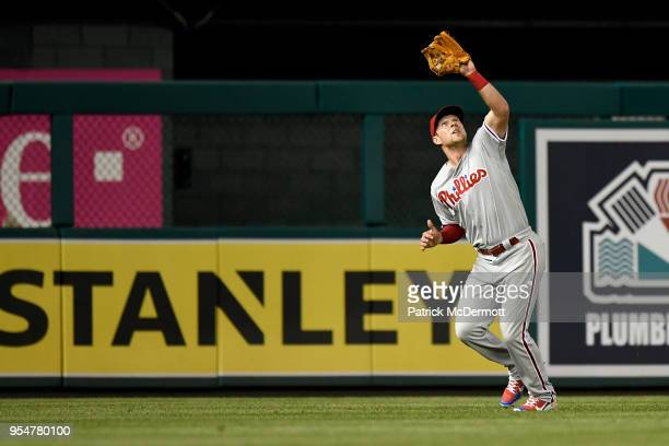 Rhys Hoskins of the Philadelphia Phillies catches a fly ball hit by Bryce Harper of the Washington Nationals in the eighth inning at Nationals Park...