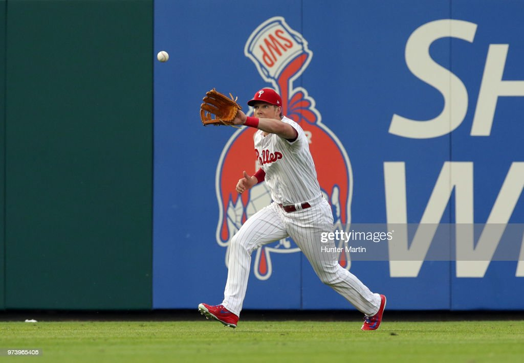 Rhys Hoskins #17 of the Philadelphia Phillies catches a fly ball in the first inning during a game against the Colorado Rockies at Citizens Bank Park on June 13, 2018 in Philadelphia, Pennsylvania. The Rockies won 7-2.