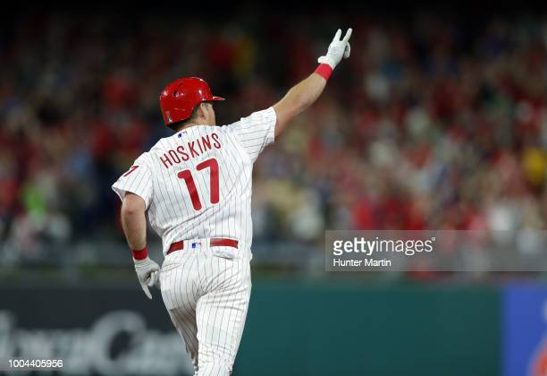 Rhys Hoskins of the Philadelphia Phillies celebrates after hitting a threerun home run in the fifth inning during a game against the Los Angeles...
