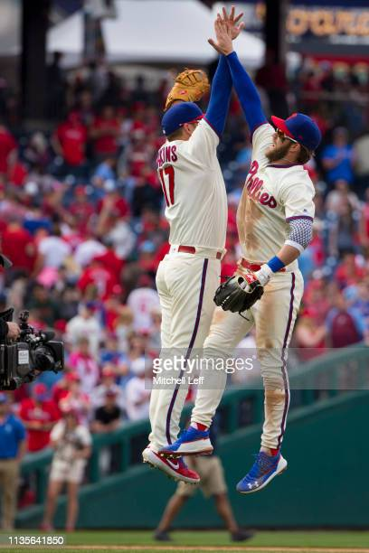 Rhys Hoskins of the Philadelphia Phillies celebrates with Bryce Harper after the game against the Minnesota Twins at Citizens Bank Park on April 7...