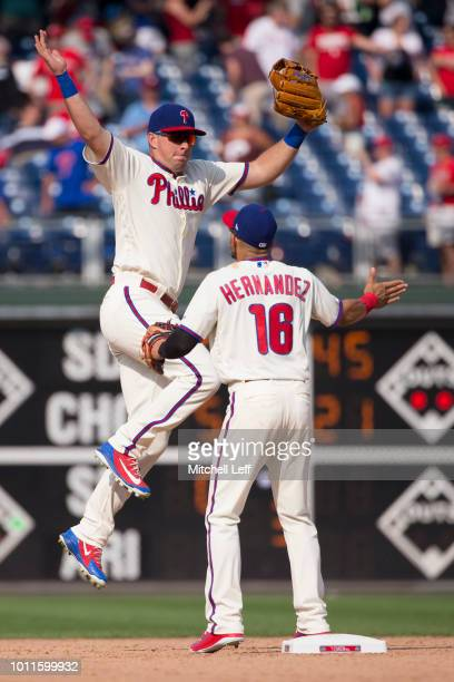 Rhys Hoskins of the Philadelphia Phillies celebrates with Cesar Hernandez after the game against the Miami Marlins at Citizens Bank Park on August 5...