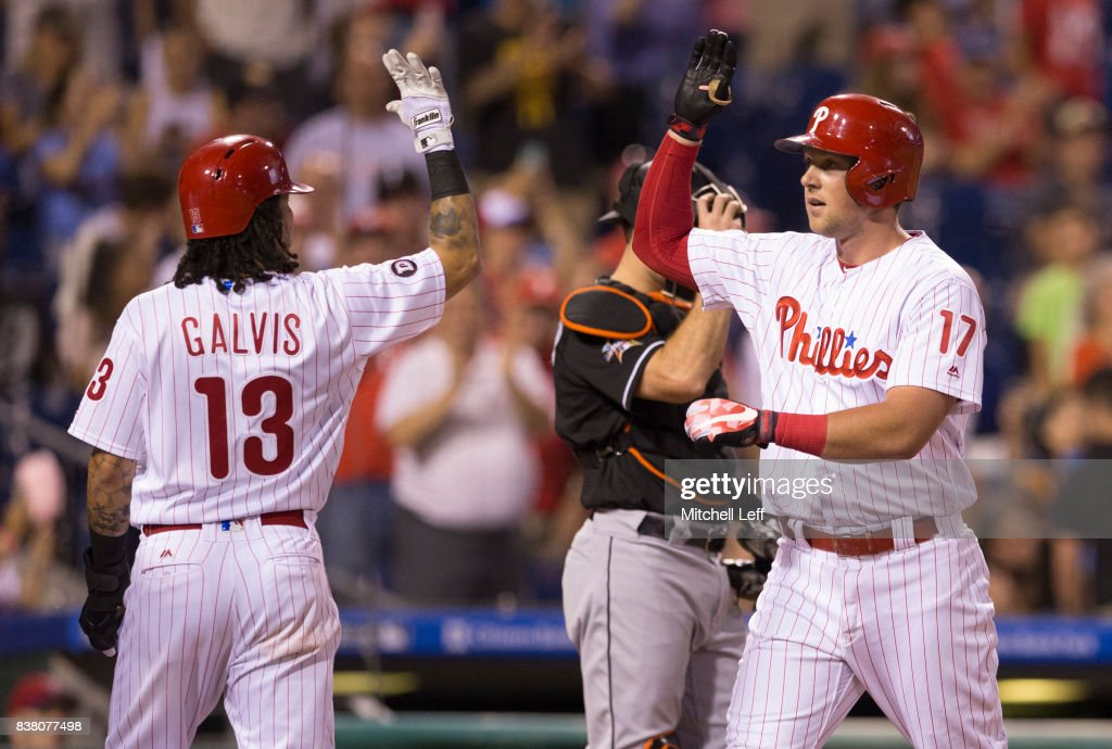 Rhys Hoskins #17 of the Philadelphia Phillies celebrates with Freddy Galvis #13 after hitting a three run home run in the bottom of the third inning against the Miami Marlins at Citizens Bank Park on August 23, 2017 in Philadelphia, Pennsylvania. The Phillies defeated the Marlins 8-0.