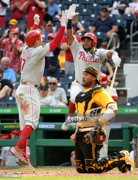 Rhys Hoskins of the Philadelphia Phillies celebrates with Maikel Franco after hitting a home run in the eleventh inning during the game against the...