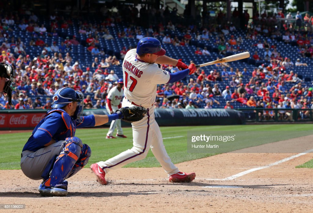 Rhys Hoskins #17 of the Philadelphia Phillies collects his first major league hit as he singles to right field in the fifth inning during a game against the New York Mets at Citizens Bank Park on August 13, 2017 in Philadelphia, Pennsylvania. The Mets won 6-2.