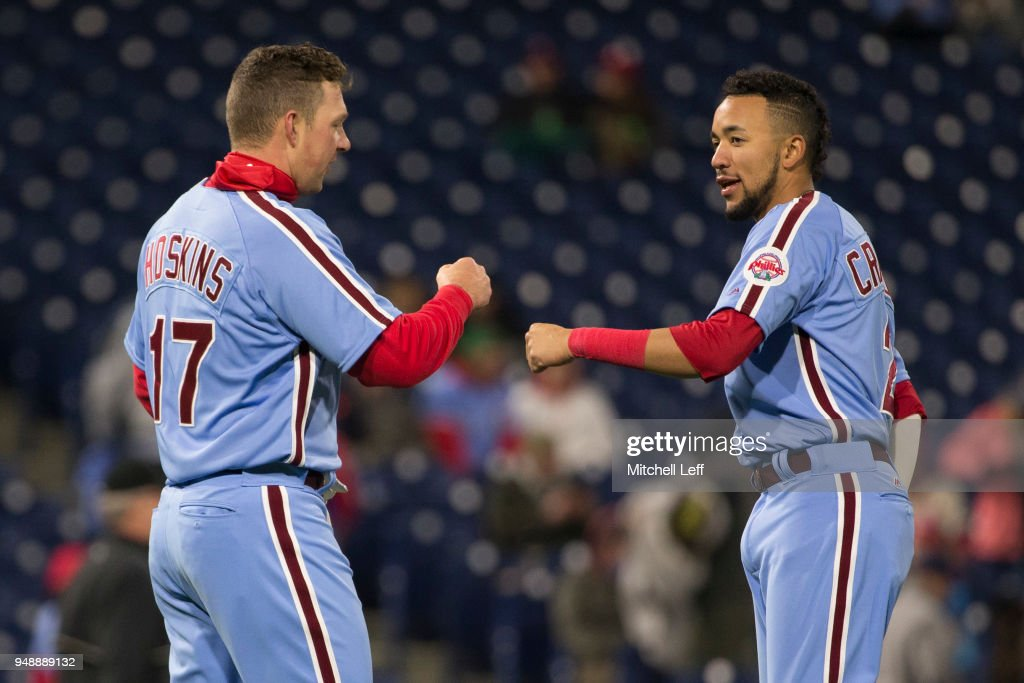 Rhys Hoskins #17 of the Philadelphia Phillies fist bumps J.P. Crawford #2 after the end of the fifth inning against the Pittsburgh Pirates at Citizens Bank Park on April 19, 2018 in Philadelphia, Pennsylvania. The Phillies defeated the Pirates 7-0.