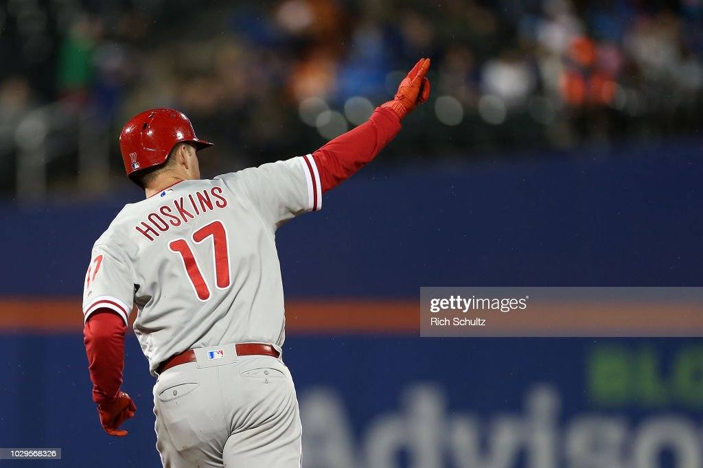 Rhys Hoskins #17 of the Philadelphia Phillies gestures after he hits a home run against the New York Mets during the sixth inning of a game at Citi Field on September 8, 2018 in the Flushing neighborhood of the Queens borough of New York City. The Mets defeated the Phillies 10-5.