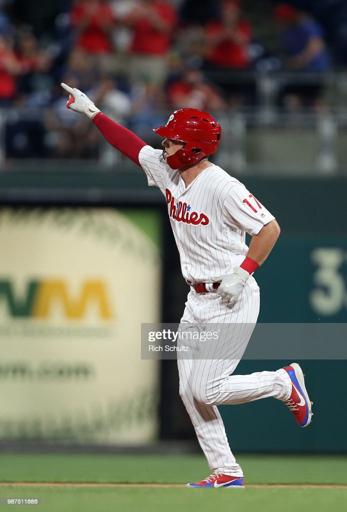 Rhys Hoskins #17 of the Philadelphia Phillies gestures after he hits a home run against the Washington Nationals during the fifth inning of a game at Citizens Bank Park on June 29, 2018 in Philadelphia, Pennsylvania. The Nationals defeated the Phillies 17-7.