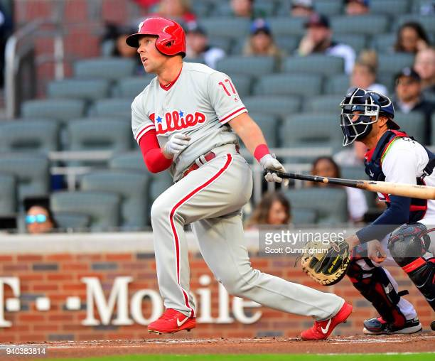 Rhys Hoskins of the Philadelphia Phillies hits a first inning single to knock in a run against the Atlanta Braves at SunTrust Park on March 31 2018...