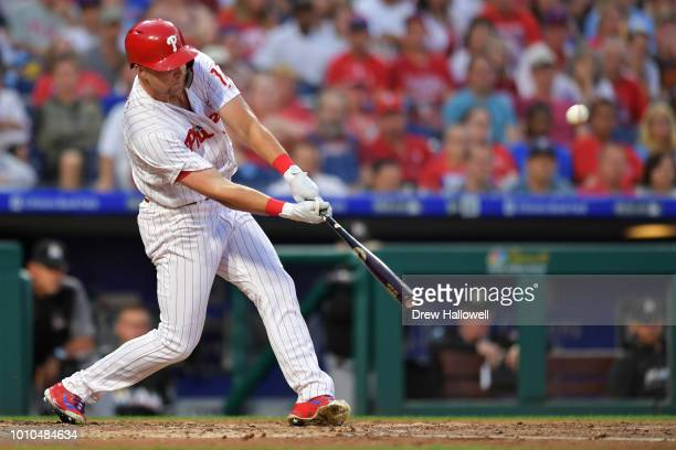 Rhys Hoskins of the Philadelphia Phillies hits a one run single int he third inning against the Miami Marlins at Citizens Bank Park on August 3 2018...