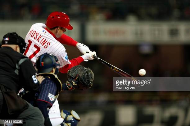 Rhys Hoskins of the Philadelphia Phillies hits a solo home run in the second inning during Game 4 of the Japan AllStar Series against Team Japan at...