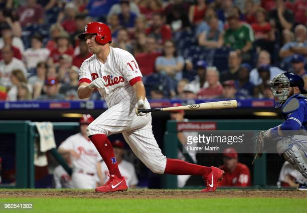 Rhys Hoskins of the Philadelphia Phillies hits an RBI double in the eighth inning during a game against the Toronto Blue Jays at Citizens Bank Park...
