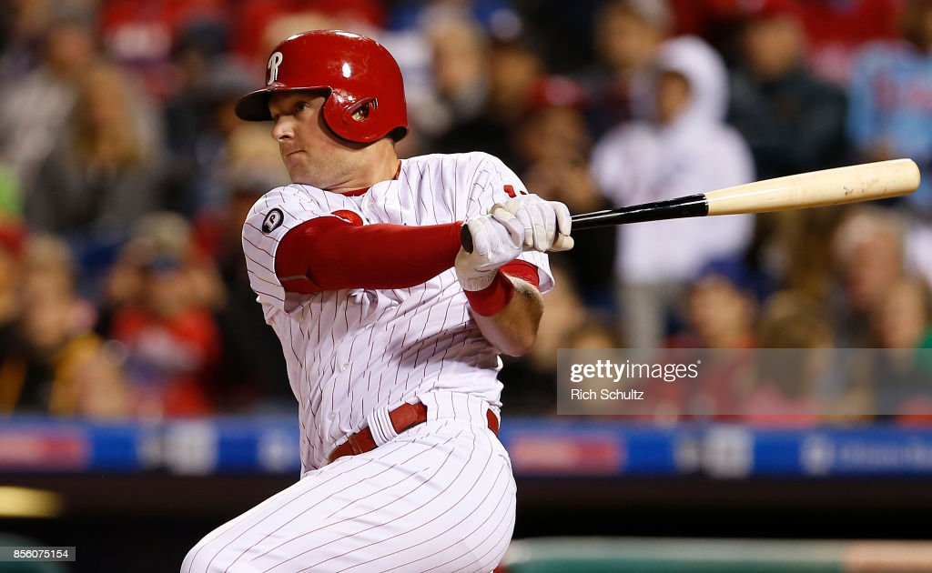Rhys Hoskins #17 of the Philadelphia Phillies hits an RBI single against the New York Mets during the seventh inning of a game at Citizens Bank Park on September 30, 2017 in Philadelphia, Pennsylvania.