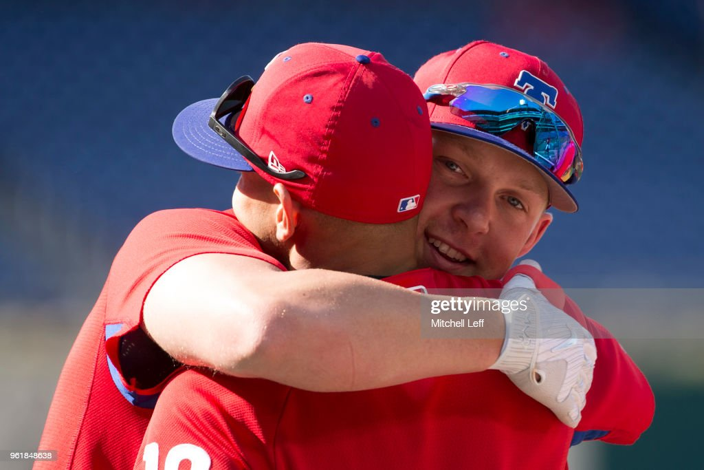 Rhys Hoskins #17 of the Philadelphia Phillies hugs Cesar Hernandez #16 prior to the game against the Atlanta Braves at Citizens Bank Park on May 23, 2018 in Philadelphia, Pennsylvania.