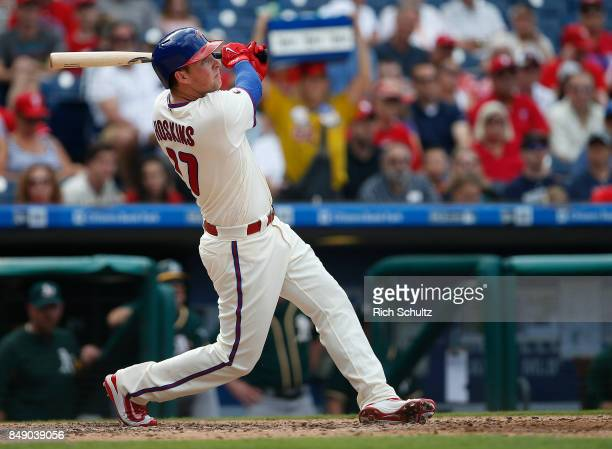 Rhys Hoskins of the Philadelphia Phillies in action against the Oakland Athletics during a game at Citizens Bank Park on September 17 2017 in...