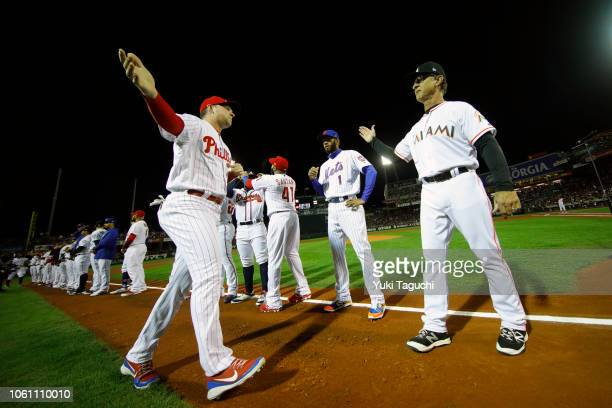 Rhys Hoskins of the Philadelphia Phillies is greeted by manager Don Mattingly of the Miami Marlins during player introductions prior to Game 4 of the...
