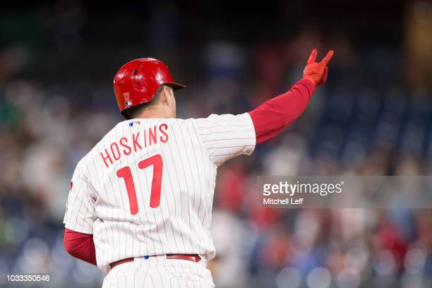 Rhys Hoskins of the Philadelphia Phillies reacts after hitting a two run home run in the bottom of the sixth inning against the Miami Marlins at...