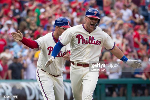 Rhys Hoskins of the Philadelphia Phillies reacts after hitting a two run home run in the bottom of the sixth inning against the Minnesota Twins at...