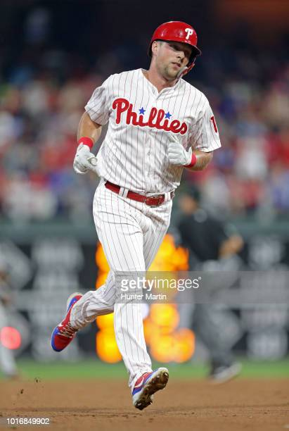 Rhys Hoskins of the Philadelphia Phillies rounds the bases after hitting a solo home run in the fifth inning during a game against the Boston Red Sox...