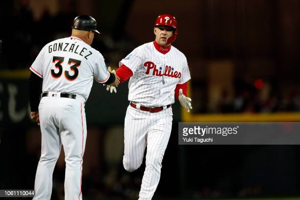 Rhys Hoskins of the Philadelphia Phillies rounds the bases after hitting a solo home run in the second inning during Game 4 of the Japan AllStar...