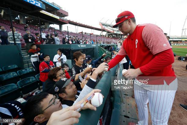 Rhys Hoskins of the Philadelphia Phillies signs autographs prior to the game Game 4 of the Japan AllStar Series against Team Japan at Mazda Zoom Zoom...