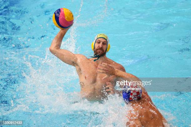 Rhys Howden of Team Australia on attack against Paulo Obradovic of Team Croatia during the Men's Preliminary Round Group B match between Australia...